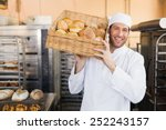 baker holding basket of bread... | Shutterstock . vector #252243157