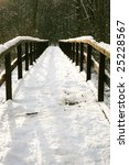Secluded place in forest , Wooden footbridge covered with the snow. Winter scenery. - stock photo