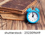 vintage books and an alarm... | Shutterstock . vector #252309649