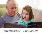 cute little girl reading a book ... | Shutterstock . vector #252362329