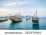 Stock photo dhows moored off museum park in central doha qatar arabia with some of the buildings from the 252379561