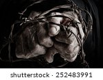 prisoner of war in barbed wire | Shutterstock . vector #252483991