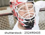 Small photo of A young teen hockey goaler outside in the arena