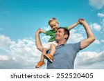 son seating on the father under ... | Shutterstock . vector #252520405