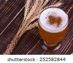 glass of beer on wooden... | Shutterstock . vector #252582844