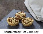 Three Mini Apple Pies On A...