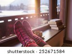 feet in woollen socks by the... | Shutterstock . vector #252671584