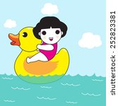 happy kid on a big rubber duck... | Shutterstock .eps vector #252823381