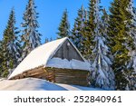 Wooden Hut Covered With Fresh...