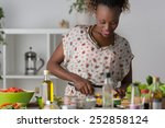 young african woman cooking.... | Shutterstock . vector #252858124