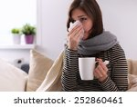 sick woman covered with blanket ... | Shutterstock . vector #252860461
