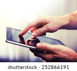 male hands typing on a tablet... | Shutterstock . vector #252866191