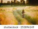 Young Man Cycling On A Rural...