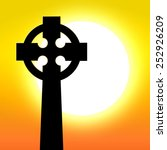 celtic cross in front of sunset   Shutterstock .eps vector #252926209