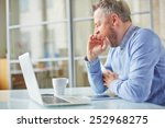 tired man yawning at workplace... | Shutterstock . vector #252968275