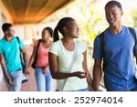 Stock photo lovely african college students walking in building corridor 252974014