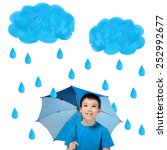 happy boy with blue umbrella... | Shutterstock . vector #252992677