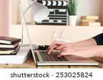 female hands of scriptwriter... | Shutterstock . vector #253025824