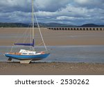Yacht On The Shore At Low Tide...