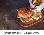 fresh burger closeup on wooden... | Shutterstock . vector #253086991
