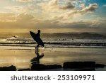 Surfers On The Beach. Sunset O...