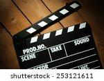 movie clapper on wooden... | Shutterstock . vector #253121611
