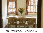 A Dining Room In A Traditional...