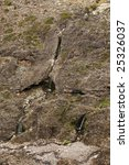 waterfall in rocky mountainside.... | Shutterstock . vector #25326037