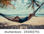 A Young Woman Is Relaxing In A...