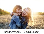 two young girls have fun outside | Shutterstock . vector #253331554