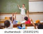 pupils raising their hands... | Shutterstock . vector #253352191
