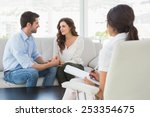 reconciled couple smiling at... | Shutterstock . vector #253354675