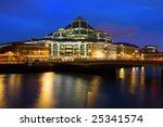 Contemporary architecture of modern office building at night in Dublin downtown, Ireland, reflections on river Liffey waters. - stock photo