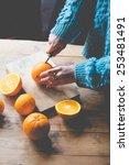 Person Cutting Fresh Oranges O...