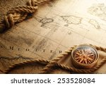 old compass and rope on vintage ... | Shutterstock . vector #253528084