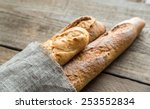 Three Baguettes On The Wooden...