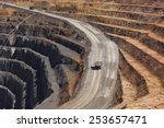 Two Trucks Transport Gold Ore...