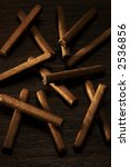 cigarillos on wooden surface | Shutterstock . vector #2536856