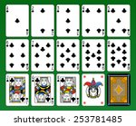 Playing cards, club suite, joker and back. Green background. - stock photo
