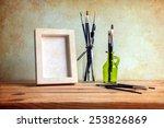 Постер, плакат: White photo frame and