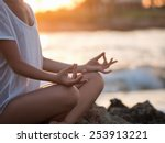 young girl meditating at the sea | Shutterstock . vector #253913221