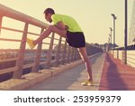 stretching after jogging on a... | Shutterstock . vector #253959379