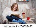charming young woman relaxing... | Shutterstock . vector #254052655