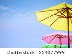Bright Colored Umbrellas On Th...