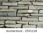 Gray slate stone wall. - stock photo