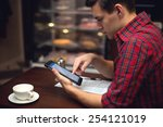 young  man drinking coffee or... | Shutterstock . vector #254121019