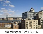 A view of the Williamsburg Bridge and the East River in Manhattan as seen from Brooklyn. - stock photo