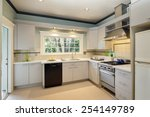 White Kitchen In Traditional...
