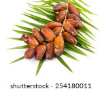 Bunch Of Date Fruits With Palm...