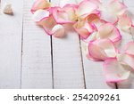 Rose Petals On White Wooden...
